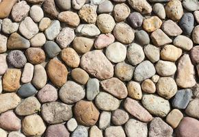 fundo de pedras da parede foto