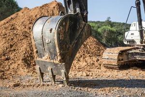 máquina de escavadeira carregador em um canteiro de obras foto