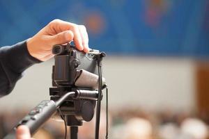 mão na câmera foto