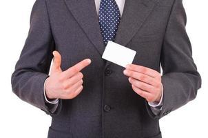 homem de negócios, mostrando o cartão em branco. foto