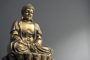 Buda sentado dourado foto