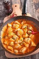 frango cozido com curry foto