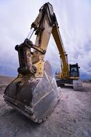 close-up de uma caçamba de escavadeira hidráulica foto