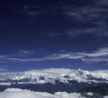 o motor de asa-delta no céu - nepal foto