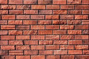 close-up da parede de tijolo vermelho foto