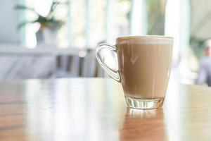 xícara de café com leite quente foto
