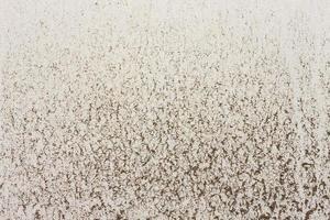 manchas de argila em fundo de textura de concreto amarelo