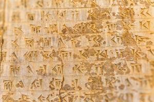 letras cuneiformes Persépolis foto
