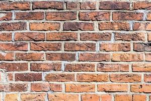 fragmento de parede de tijolo vermelho foto