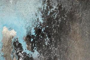 superfície rouca, arranhada e descascada com tinta azul e preta foto