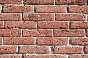 parede de tijolos vermelhos foto