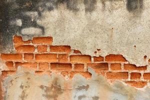 fundo de parede de tijolo vintage de concreto rachado foto