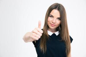 retrato de uma menina feliz aparecendo o polegar foto