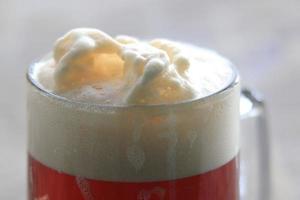 espuma em um copo de cerveja