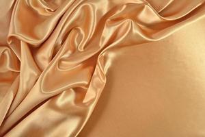 fundo de tecido de cetim dourado foto