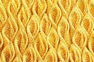 seda de tecido plissado ouro para o fundo foto