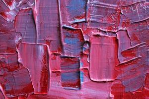 detalhe de uma pintura acrílica azul e rosa.