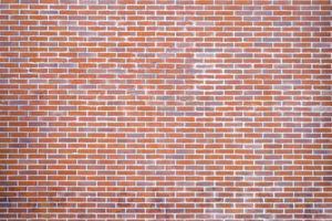 parede de tijolo laranja e vermelho foto