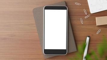 disposição plana de uma maquete de smartphone em uma mesa foto