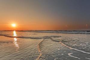 nascer do sol na ilha hilton head foto