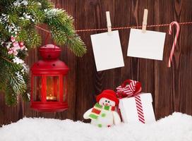 lanterna de vela de natal, caixa de presente e fotos