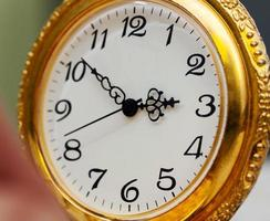 relógio de bolso do vintage foto