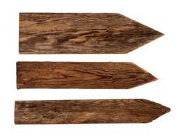 três tamanhos de sinais de flecha de madeira escura foto