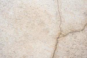 textura de parede de cimento rachada foto