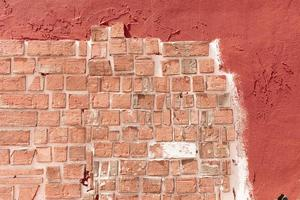 textura de parede de tijolo laranja foto