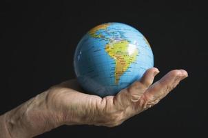 mundo em sua mão foto