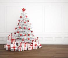 árvore de natal branca e vermelha em quarto vazio foto