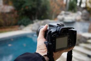 como segurar a câmera