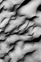 fotografia monocromática de areia foto