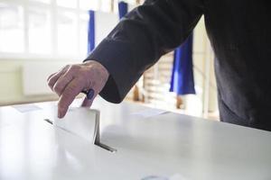 mão votante foto