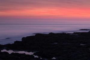 porthcawl, gales do sul, reino unido, ao pôr do sol.
