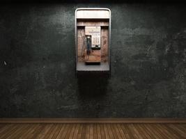 parede de concreto velha e cabine telefônica