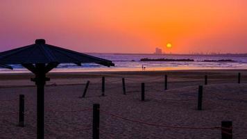 lindo pôr do sol em agadir, marrocos foto