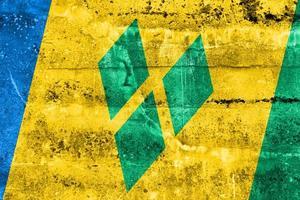 São Vicente e a bandeira das Granadinas pintada na parede do grunge foto