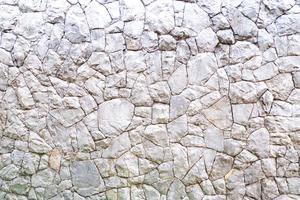 parede de pedra de rocha envelhecida abstrata foto