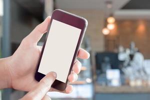 maquete de smartphone em um café foto
