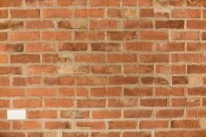 textura ou fundo de parede de tijolo laranja foto