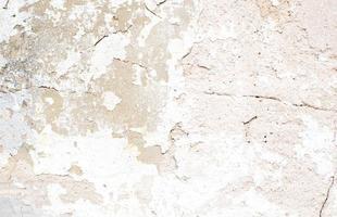 textura bege de parede com pintura lascada foto