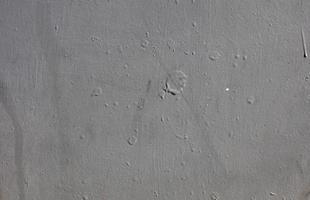 textura de parede de concreto com respingos de tinta foto