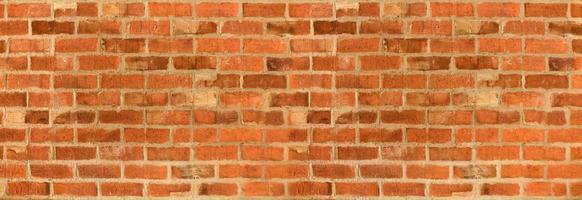 panorama da textura ou fundo laranja da parede de tijolo foto
