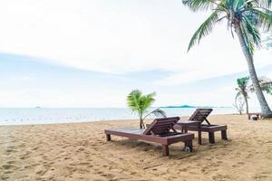 ilha paradisíaca cadeira de praia fundo foto
