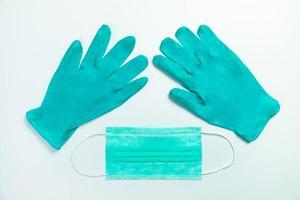 máscara de proteção médica azul e luvas, vista superior