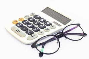 calculadora e óculos