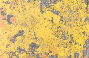 textura amarela da parede do grunge foto