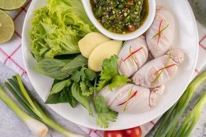 lula recheada de porco cozido com molho de frutos do mar foto