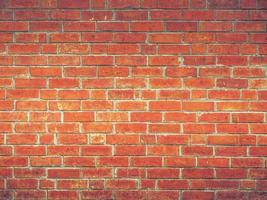 parede de tijolo vermelho com luz foto